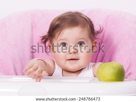 Adorable baby girl with green apple  - stock photo