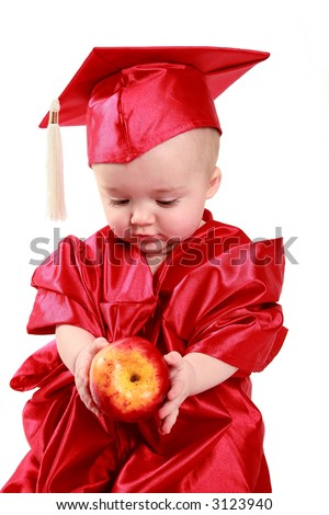 adorable baby in a red cap and gown. - stock photo