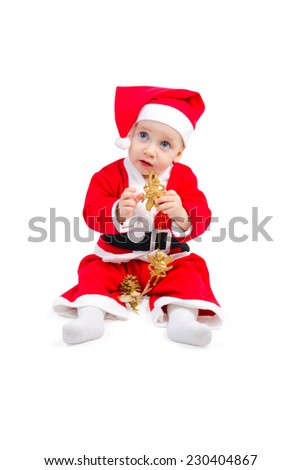 Adorable baby in the costume of Santa Claus is sitting on the floor isolated on white background - stock photo