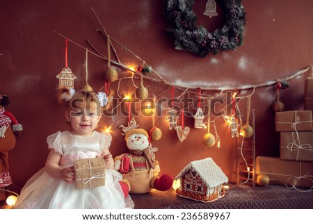 adorable baby in the room with gifts - stock photo