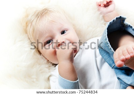 adorable baby is smiling - stock photo