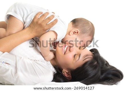 adorable baby kissing his beautiful mom isolated on white - stock photo