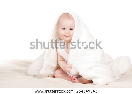 Adorable baby, looking out under a white blanket/towel. child under blanket. Little baby under white towel. series - stock photo