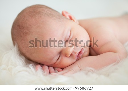 adorable baby newborn sleeping on stomach - stock photo