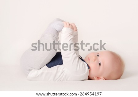 Adorable baby play on white background - stock photo