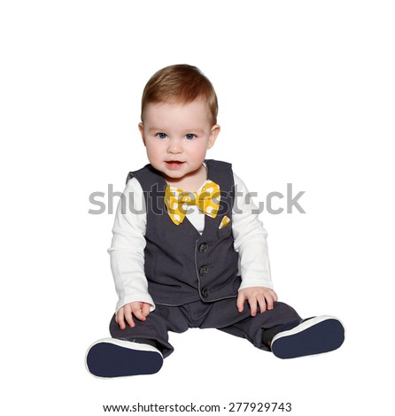 adorable baby wearing classic vest and colorful bowtie on white background - stock photo