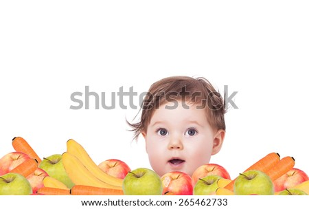 Adorable baby with bunch of fruits - stock photo