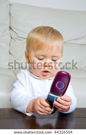 adorable baby with cell phone - stock photo
