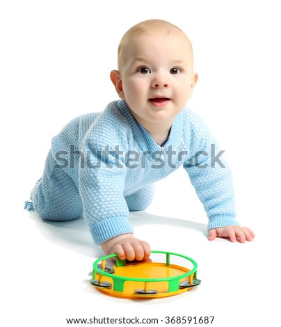 Adorable baby with plastic colourful tambourine isolated on white background - stock photo