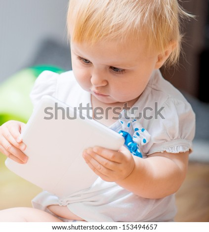 adorable baby with tablet PC - stock photo