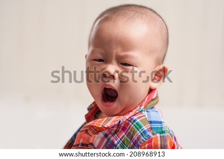Adorable baby yawning - stock photo
