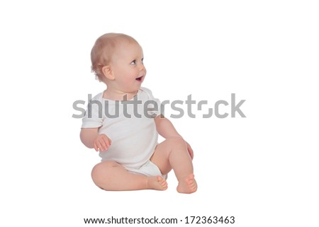 Adorable blonde baby sitting on the floor isolated on a white background - stock photo