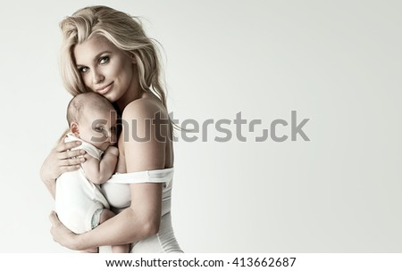 Adorable blonde mom and baby  - stock photo