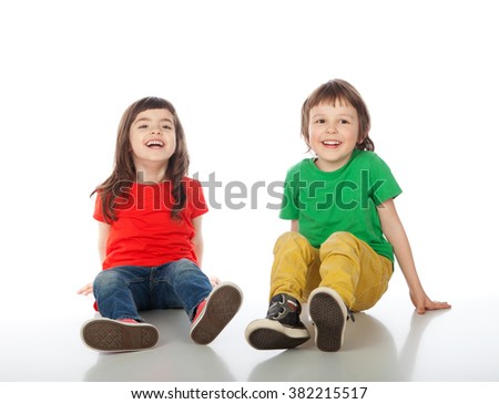 Adorable boy and girl having great time, isolated on white - stock photo