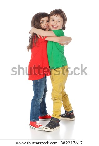 Adorable boy and girl hugging, isolated on white - stock photo
