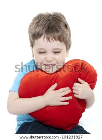 Adorable boy cuddling heart - stock photo