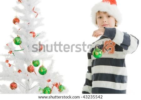 adorable Boy decorating Christmas tree - stock photo