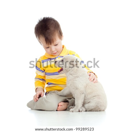 adorable boy playing with a puppy - stock photo