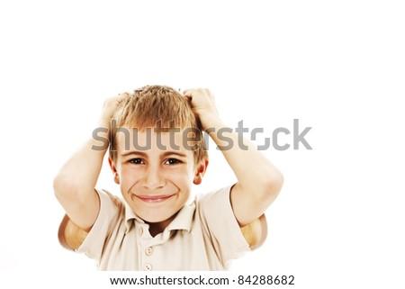Adorable boy upset. Isolated over white background - stock photo