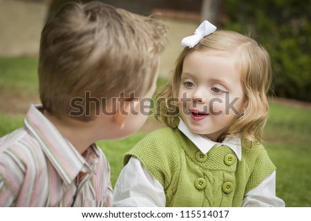 Adorable Brother and Sister Children Playing with Each Other Outside. - stock photo