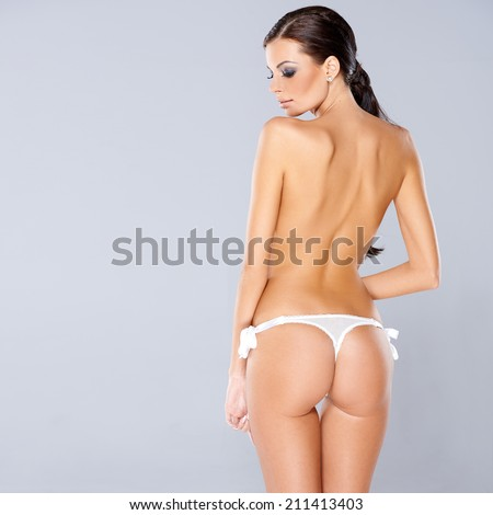 Adorable brunette girl posing isolated with copy space - stock photo