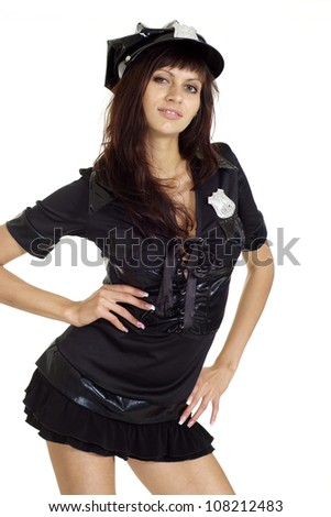Adorable brunette in a suit of police on a white background - stock photo