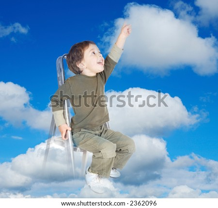 adorable child over clouds making reality its dreams - stock photo