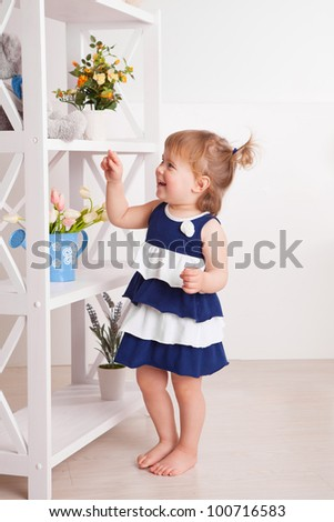 Adorable child playing at home - stock photo