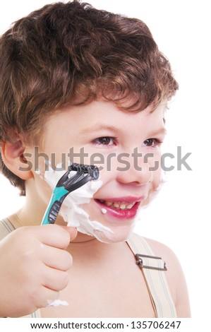 Adorable child shaving isolated on white background - stock photo