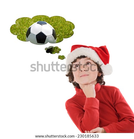 Adorable child with Christmas hat thinking with a soccer ball isolated on a white background - stock photo