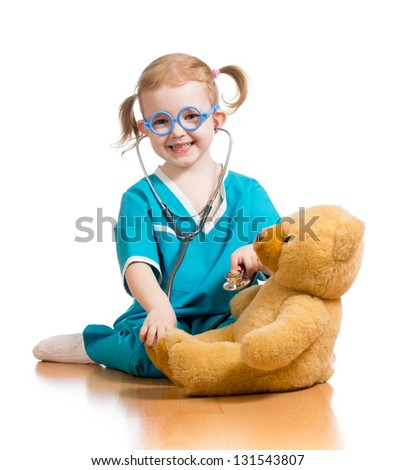 Adorable child with clothes of doctor over white - stock photo