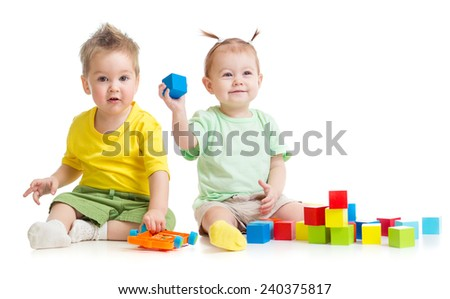 Adorable children playing colorful toys isolated - stock photo