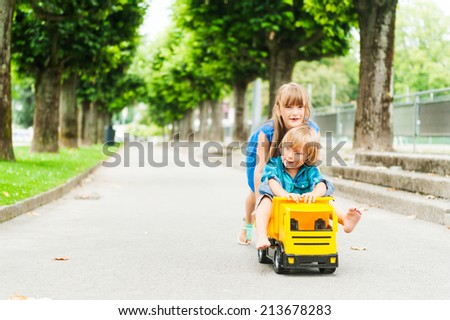 Adorable children playing together outdoors - stock photo