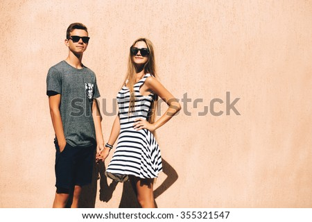 Adorable couple on a sunny day in the city - stock photo