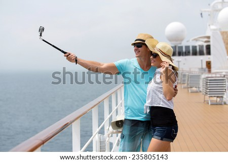 adorable couple taking self portrait on cruise - stock photo