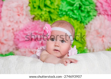 adorable cute nice baby portrait close up on spring colors background - stock photo