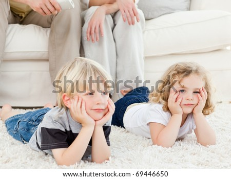 Adorable family watching tv in the living room - stock photo