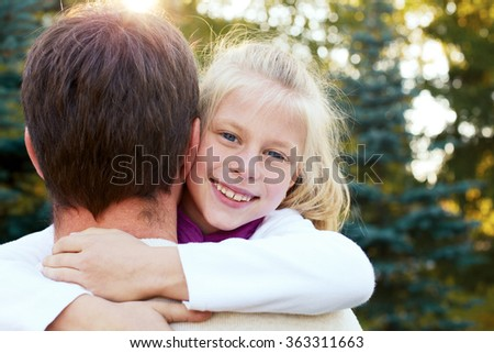 adorable father and daughter have fun together happy smiles. healthy lifestyle - stock photo