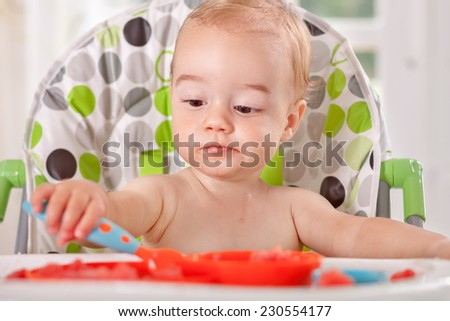 Adorable funny baby enjoy to eat watermelon - stock photo