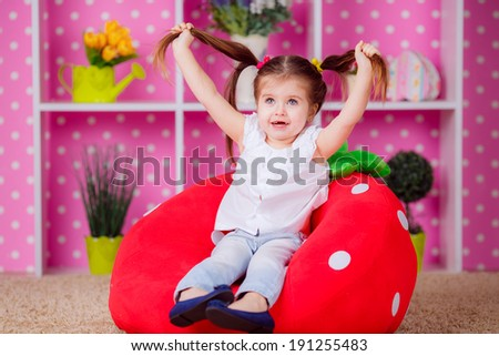 Adorable girl in the nursery. emotions, fun, smile, children's world - stock photo