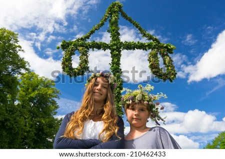 Adorable girls on midsummer Swedish party - stock photo