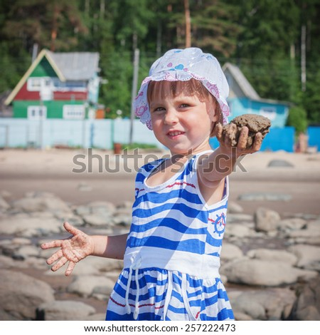 Adorable happy smiling little girl on beach vacation - stock photo