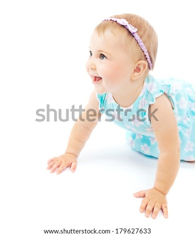 Adorable little baby girl laughing, crawling and playing at studio, isolated on white background, wearing stylish head decor, happy childhood concept - stock photo