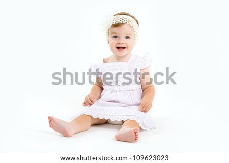 Adorable little baby girl laughing, creeping & playing in the studio, isolated on white background - stock photo