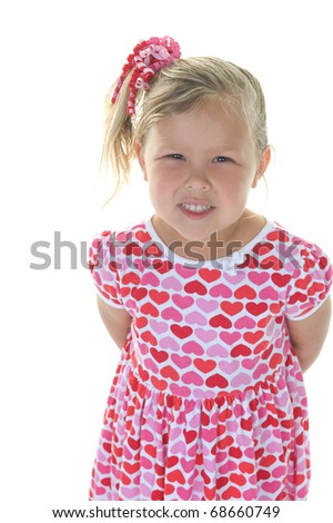Adorable little blond girl smiling in the studio wearing hearts for Valentine's Day - stock photo