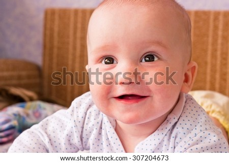 Adorable little boy happy portrait. Looking up and laughing. Toned image - stock photo
