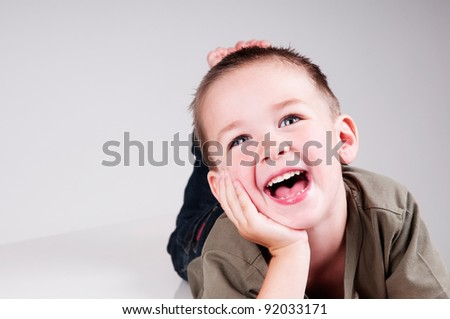 adorable little boy laughing - stock photo