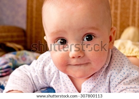 Adorable little boy surprised portrait. Looking at camera. Toned in warm colors - stock photo