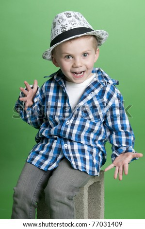 Adorable little boy wearing blue plaid shirt - stock photo