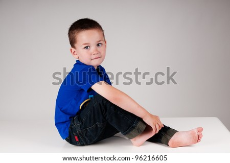 adorable little boy with blue shirt - stock photo